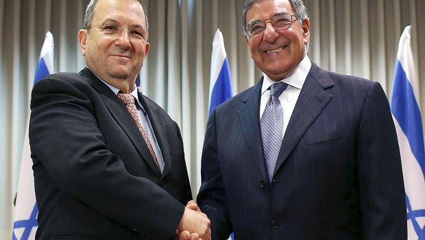 Secretary of Defense Leon Panetta shakes hands with Israeli Defense Minister Ehud Barak