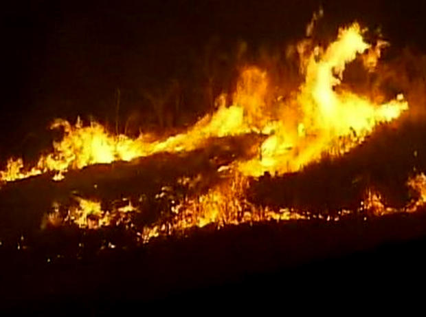 A house burns from a wildfire in Kittitas County, Wash., on Aug. 14, 2012.