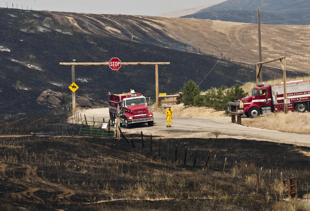 Wildfires burn across the West