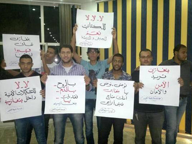 """Save Benghazi"" protesters show off placards"