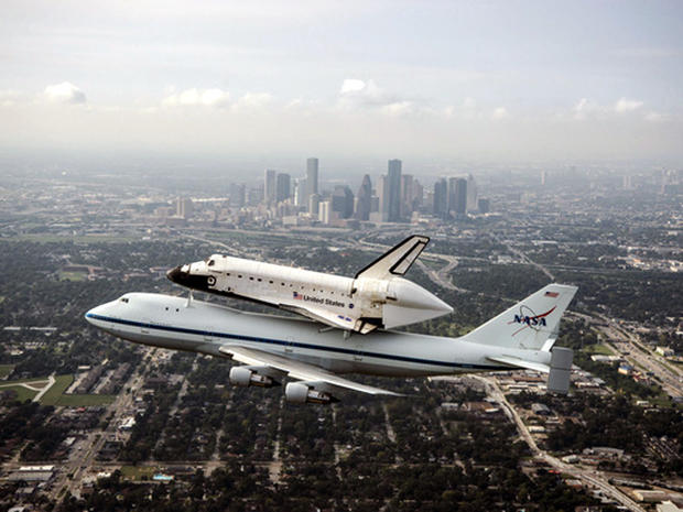 Space Shuttle Endeavour is ferried by NASA's Shuttle Carrier Aircraft (SCA) over Houston, Texas on September 19, 2012, during a three-day flight to Los Angeles, where the shuttle will be put on public display at the California Science Center.