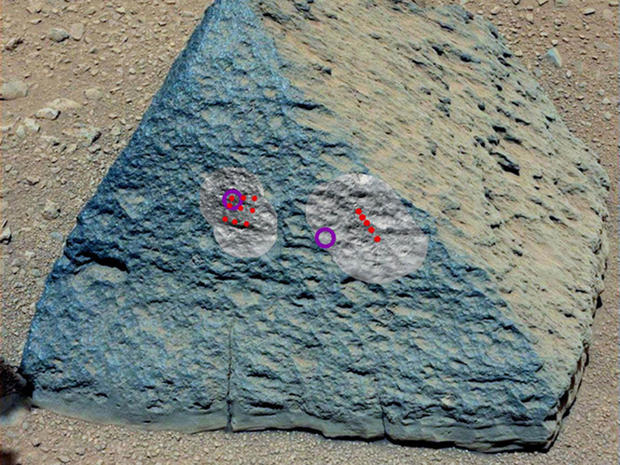 "This image shows where NASA's Curiosity rover aimed two different instruments to study a rock known as ""Jake Matijevic"" in late September 2012. The red dots indicate where Curiosity fired its laser at the rock."