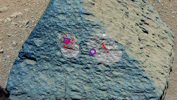 """This image shows where NASA's Curiosity rover aimed two different instruments to study a rock known as """"Jake Matijevic"""" in late September 2012. The red dots indicate where Curiosity fired its laser at the rock."""