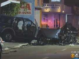 Three people were killed Saturday when a car that was apparently drag racing slammed into an SUV carrying a couple and their two sons.