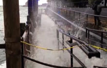 Hurricane Sandy pushing water over Manhattan seawall