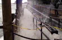 Hurricane Sandy pushing water over Manhattan seawall
