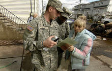 Rescue workers searching homes for Sandy victims