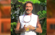 "McAfee founder ""person of interest"" in neighbor death"