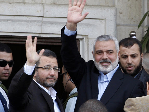 Gaza's Hamas Prime Minister Ismail Haniyeh, right, and Egyptian Prime Minister Hesham Kandil, in Gaza City