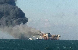 In this image released by a oil field worker and obtained by the Associated Press, a fire burns on a Gulf oil platform Friday, Nov. 16, 2012, after an explosion on the rig, in the Gulf of Mexico off the Louisiana coast.