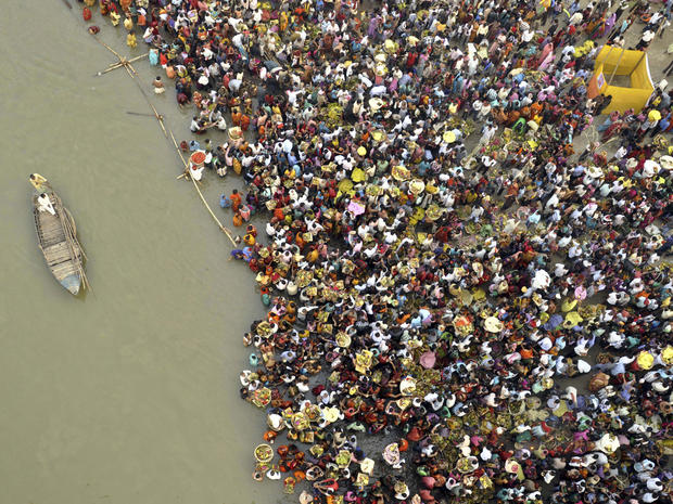 Hindu devotees take part in worship on the banks of the River Ganges river during Chhath festival, an ancient Hindu festival, rituals are performed to thank the Sun God for sustaining life on earth, in Patna, India, Monday, Nov. 19, 2012.