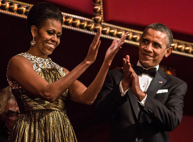 U.S. President Barack Obama and first lady Michelle Obama attend the Kennedy Center Honors at the Kennedy Center on December 2, 2012 in Washington, DC.