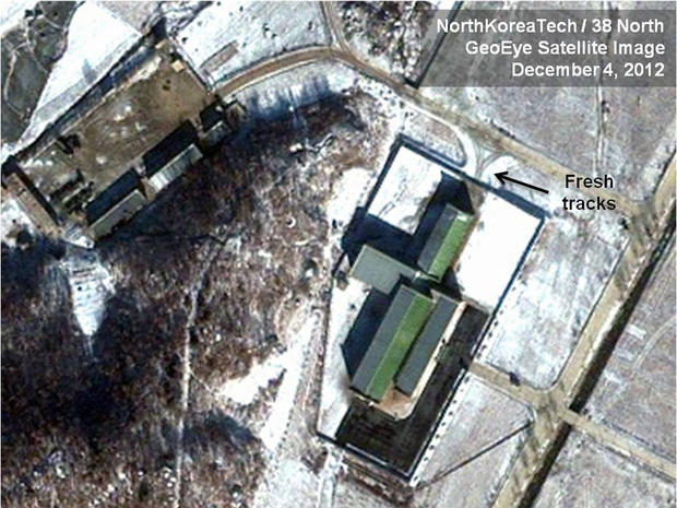Dec. 4, 2012 satellite image taken by GeoEye and annotated and distributed by North Korea Tech and 38 North shows snow covering the Sohae launching station in Tongchang-ri, North Korea, including the path where trailers would be used to move the rocket stages from the assembly building to the launch pad in preparation for a Dec. 10-22 launch. New satellite images show that heavy snowfall may have slowed North Korean rocket launch preparations but that Pyongyang could still be ready for liftoff starting Monday, Dec. 10, 2012. This image was shared with the AP by the 38 North and North Korea Tech websites, which collaborate on analysis of the satellite imagery.