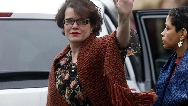 Veronika Pozner waves to the assembled press as she leaves after a funeral service for her son, 6-year-old Noah Pozner, Dec. 17, 2012, in Fairfield, Conn.