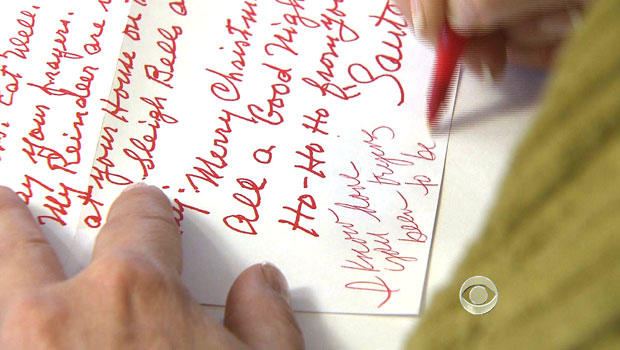 Volunteers in Santa Claus, Ind., respond to letters from children to Santa.