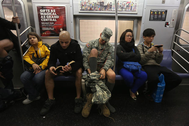 Riders strip on NYC subways
