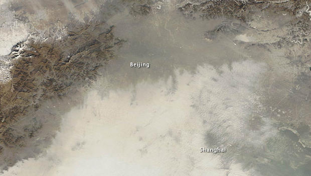 An image taken by NASA's Terra satellite on January 14 shows Beijing and the surrounding area smothered by a layer of extreme air pollution.