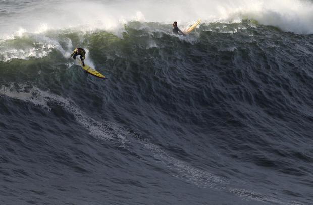 Garrett McNamara surfs possible 100-foot wave