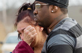 Kasmond Parker, right, consoles Cyndy Mann at the crash site where six teens were killed early in the morning on Park Ave. in Warren, Ohio on Sunday, March 10, 2013.