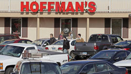 Cars jam the parking lot as shoppers leave Hoffman's Gun Center with their purchases in Newington, Conn., Tuesday, April 2, 2013. Customers are packing gun stores around Connecticut following the unveiling of new gun-control legislation, which could take effect as soon as Wednesday evening.
