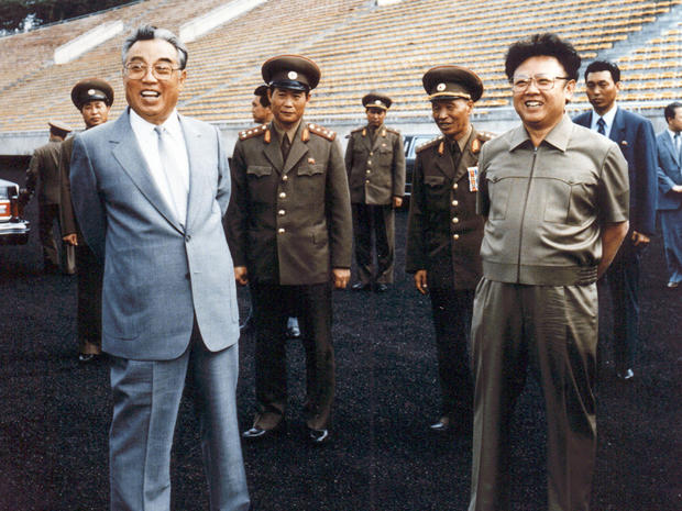 Former North Korean leaders Kim Jong-Il (R) and his father, Kim Il-Sung