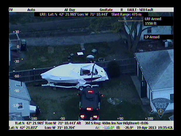 Boston bombing suspect found hiding in boat