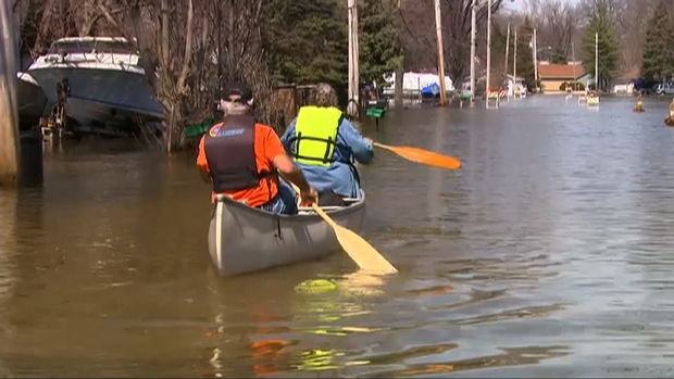 Two Fargo, N.D., residents get across the road via canoe. The Red River crested 16 feet above flood stage.