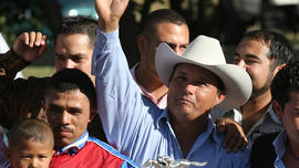 In this Sept. 6, 2010 file photo, owner Jose Trevino Morales, center, acknowledges the crowd as he stood with the trophy after Mr. Piloto won the All American Futurity horse race at Ruidoso Downs, N.M. Prosecutors told a federal jury on Wednesday, May 8, 2013 that Morales, the man they say is the brother of leaders of Mexico's most blood-soaked criminal organization, used the proceeds from their brothers' ill-gotten gains to bankroll his horse-racing stable.