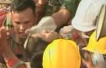 Survivor pulled from collapsed factory in Bangladesh