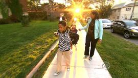 Charmin Leon takes her children to school in Cleveland.
