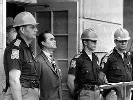 In this June 11, 1963 file photo, Gov. George Wallace blocks the entrance to the University of Alabama as he turned back a federal officer attempting to enroll two black students at the university campus in Tuscaloosa, Ala.