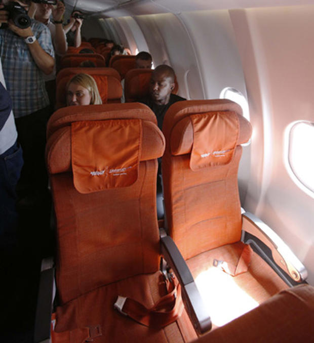 Photographers take pictures of seat 17A, the empty seat that an Aeroflot official said was booked in the name of former CIA technician Edward Snowden, on June 24, 2013.