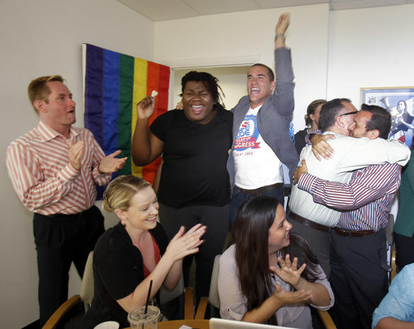 Gay rights supporters celebrate Supreme Court rulings