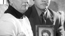 Diane Dodd and son Casey Sherman hold a picture of Dodd's sister Mary Sullivan in Rockland, Mass., March 10, 2000.
