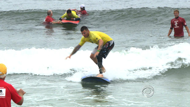 A veteran surfs during a Wounded Warriors event in Breezy Point, N.Y.