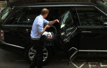 Prince William carries son to the car