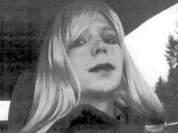 Army Pfc. Chelsea Manning poses for a picture wearing a wig and lipstick in this undated picture provided by the U.S. Army when she was known as Bradley.