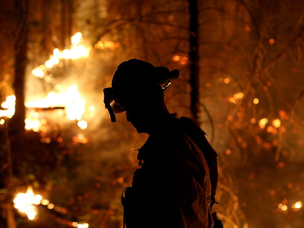 A firefighter from the Cosumnes Fire Department monitors a back fire while battling the Rim Fire Aug. 22, 2013, in Groveland, Calif., outside of Yosemite National Park.