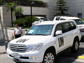 U.N. experts leave a hotel in Damascus, Syria, Aug. 30, 2013.