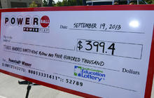 A giant check is displayed announcing a winner in the Powerball jackpot outside the Murphy Express store Sept. 19, 2013, in Lexington, S.C.