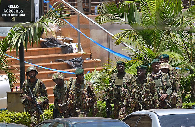 Kenyan soldiers walk outside the Westgate Mall