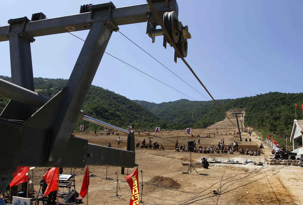 North Korean soldiers work on at building project to construct a ski resort at North Korea's Masik Pass.