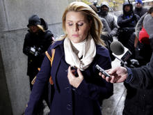 Genevieve Sabourin, who is charged with stalking actor Alec Baldwin, speaks with reporters as she arrives for her trial at criminal court on Nov. 12, 2013, in New York.