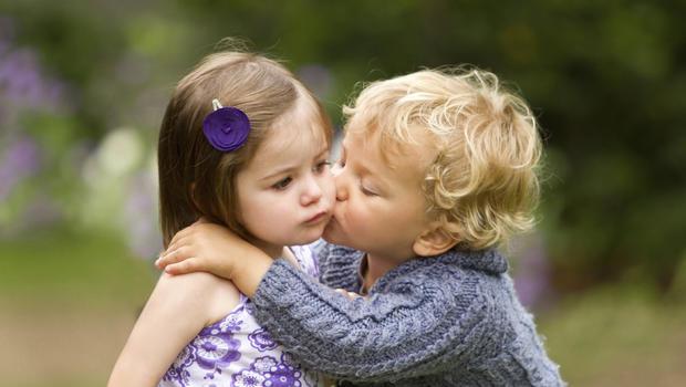 Teen boy and girl kissing