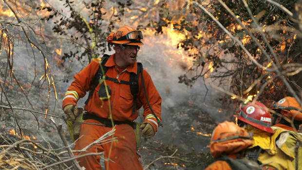 A fire crew climbs a hill at the Colby Fire in Glendora, Calif., Jan. 16, 2014.