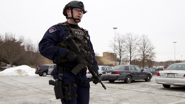 Police move in from a parking lot to the Mall in Columbia after a multiple shooting Jan. 25, 2014, in Howard County, Md.