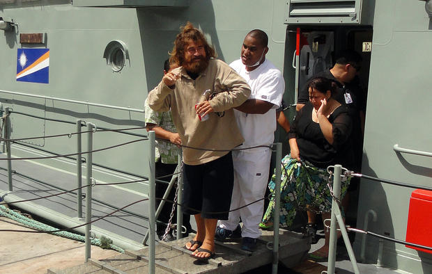 "A castaway from Mexico who identified himself as Jose Salvador Alvarenga steps off the ""Lomor"" Sea Patrol vessel in Majuro, Marshall Islands"