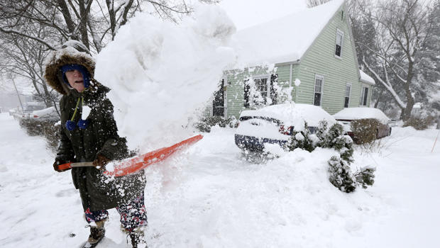 Peggy Udden, of Norwood, Mass., shovels her driveway in Norwood Feb. 5, 2014.
