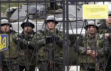 Ukraine mobilizes as Russian troops control Crimea