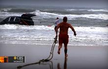 Watch: Family rescued after mother drives minivan into Atlantic Ocean